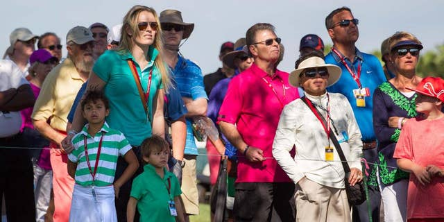 Lindsey Vonn, joined by Tiger Woods' children, Sam Alexis and Charlie Axel, watches Woods tee off on the 11th hole during the second round of the Honda Classic golf tournament in Palm Beach Gardens, Fla., Friday, Feb. 28, 2014. (AP Photo/The Palm Beach Post, Allen Eyestone) MAGS OUT  NO SALES  TV OUT
