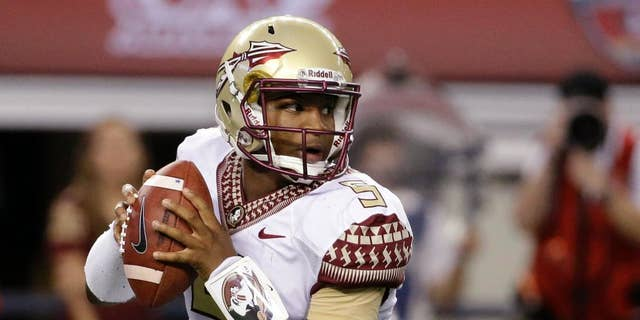 Aug. 30, 2014: Florida State quarterback Jameis Winston rolls out of the pocket in the first half of an NCAA college football game against Oklahoma State in Arlington, Texas.