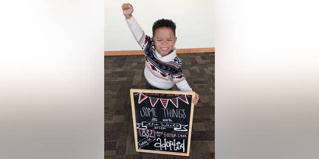 This Dec. 20, 2016 photo released by Dezhianna Brown shows her adopted brother Michael Brown in Phoenix. Brown's celebration of his adoption is a hit on social media, with thousands of retweets and likes by Friday, Dec. 23, 2016. (Dezhianna Brown via AP)