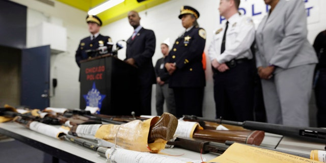Jan. 28, 2013: In this file photo, Chicago Police First Deputy Superintendent Alfonsa Wysinger, second from left, speaks at a news conference in Chicago with a display of recently seized guns, part of the 574 that had been seized in the city since Jan. 1. The mounting homicide toll in President Barack Obamas hometown is giving ammunition to both sides in the nations debate about gun rights and safety. The city suffered through its deadliest January in more than a decade.