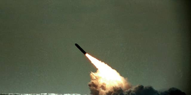 FILE - In this file photo dated Monday, Dec. 4, 1989, a Trident II missile launched by the U.S. Navy during a performance evaluation from the submerged submarine USS Tennessee in the Atlantic Ocean off the coast of Cape Canaveral in Titusville, Fla., USA.