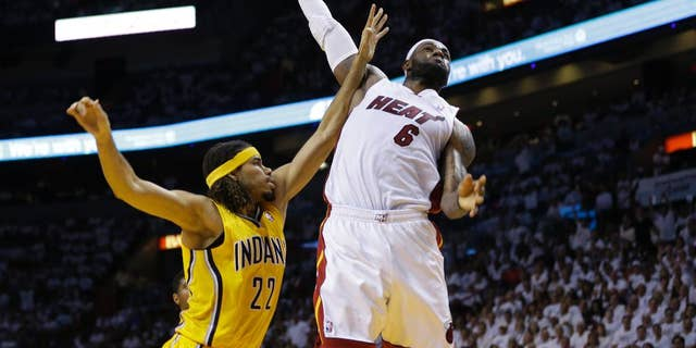 Miami Heat forward LeBron James (6) drives to dunk the ball over Indiana Pacers forward Chris Copeland (22) during the second half Game 6 in the NBA basketball playoffs Eastern Conference finals on Friday, May 30, 2014, in Miami. (AP Photo/Lynne Sladky)