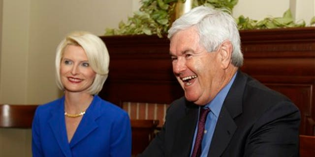 March. 3: Former House Speaker Newt Gingrich, R-Ga., speaks as his wife Callista looks on during a meeting with Gov. Nathan Deal in the Governor's office in Atlanta. Fox News contributors Newt Gingrich and Rick Santorum have been put on leave from the cable news channel for 60 days, as the two contemplate whether they will run for the 2012 Republican presidential nomination.