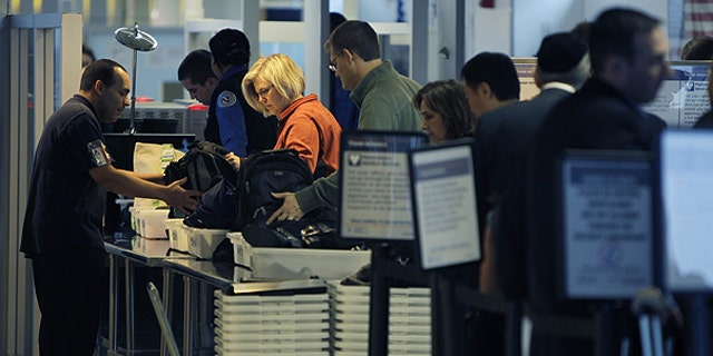 Nov. 23: Travelers make their way through a security checkpoint at LaGuardia Airport in New York.