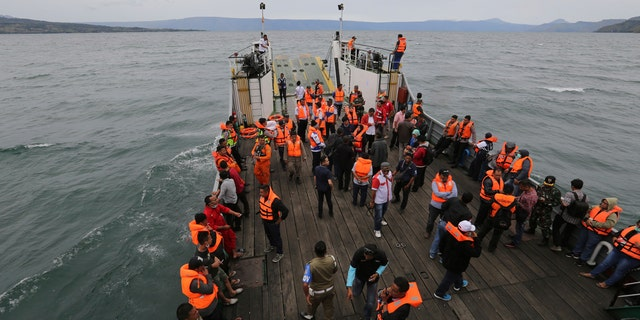 An Indonesia search and rescue team searches for a ferry which sank Monday in lake Toba, North Sumatra, Indonesia, Tuesday, June 19, 2018.