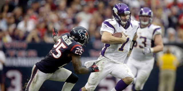 Minnesota Vikings quarterback Christian Ponder (7) runs for a first down as Houston Texans cornerback Kareem Jackson (25) defends during the fourth quarter of an NFL football game Sunday, Dec. 23, 2012, in Houston. The Vikings beat the Texans 23-6.  (AP Photo/Patric Schneider)