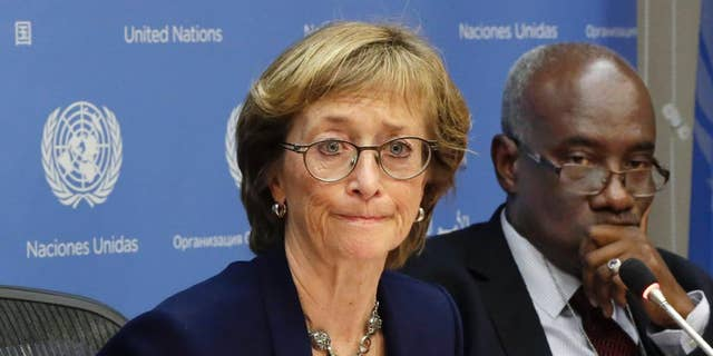 FILE - In this Thursday, Dec. 17, 2015 file photo, Judge Marie Deschamps, left, of Canada, chair of the Independent Review Panel on U.N. Response to Allegations of Sexual Abuse by Foreign Military Forces in the Central African Republic, is joined by panel member Hassan Jallow at a news conference at the United Nations. On Wednesday, March 30, 2016, a U.S.-based advocacy group says 98 girls in Central African Republic have reported that they were sexually abused by international peacekeepers and that three girls told U.N. staff they were tied up, undressed and forced to have sex with a dog by a French military commander in 2014. (AP Photo/Richard Drew)