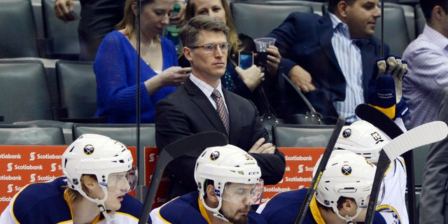 Buffalo Sabres interim head coach Ron Rolston stands behinds his players during an NHL hockey game against the Toronto Maple Leafs in Toronto, Thursday, Feb. 21, 2013. The Sabres fired head coach Lindy Ruff on Wednesday. (AP Photo/The Canadian Press, Frank Gunn)