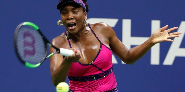 Venus Williams returns a shot to Serena Williams during the third round of the U.S. Open tennis tournament, in Flushing, N.Y., Aug. 31, 2018.