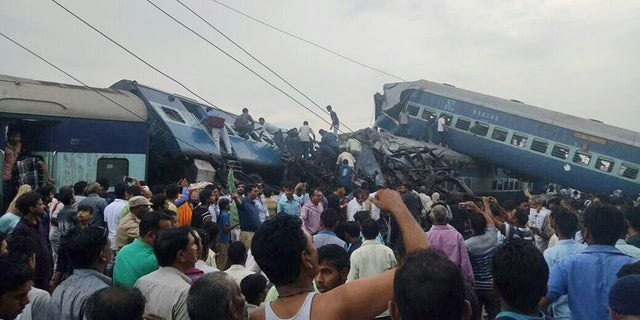 Railway police and local volunteers look for survivors in the upturned coaches of the Kalinga-Utkal Express after an accident near Khatauli, in the northern Indian state of Uttar Pradesh, Saturday, Aug. 19, 2017. Six coaches of a passenger train derailed in northern India on Saturday, killing more than 20 people and injuring dozens, officials said. (AP Photo)