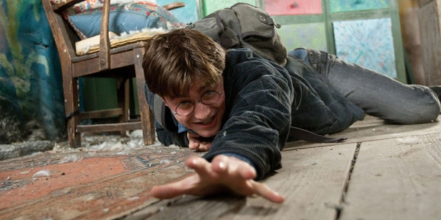"""In this film publicity image released by Warner Bros. Pictures, Daniel Radcliffe is shown in a scene from """"Harry Porter The Deathly Hallows: Part 1."""""""