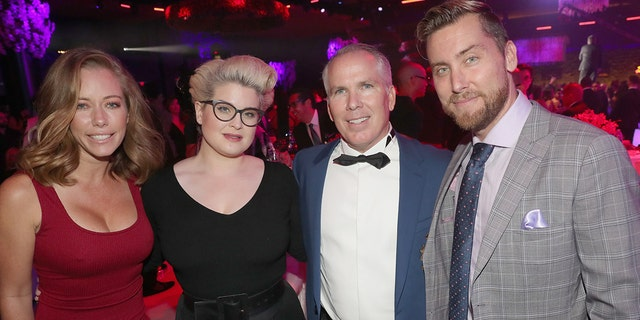 (From left) Kendra Wilkinson, Kelly Osbourne, Thomas J. Henry and Lance Bass pose for a group photo during the celebration of the Thomas J. Henry law firm's 25th anniversary in 2018 in San Antonio, Texas.