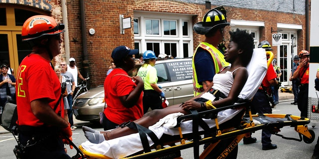 Rescue workers transporting a victim who was injured Saturday when a car drove through a group of counter-protesters in Charlottesville.
