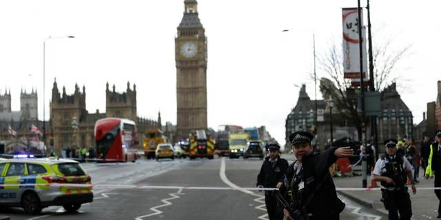 Police direct traffic approaching Westminster Bridge after the March 22, 2017 attack.