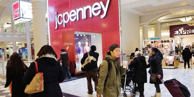 In this Feb. 19, 2015 photo, shoppers visit a J.C. Penney store, in New York. The Texas-based retailer reports quarterly financial results after the market closes Thursday, Feb. 26, 2015. (AP Photo/Mark Lennihan)