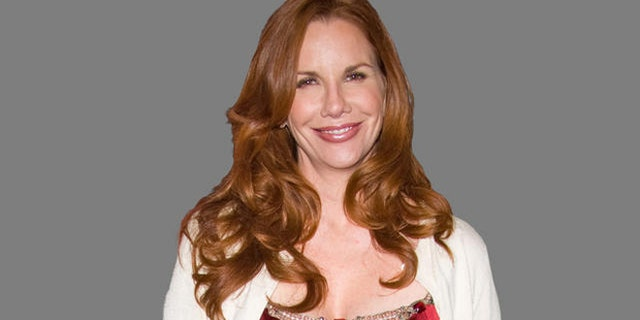 Melissa Gilbert poses for a headshot.