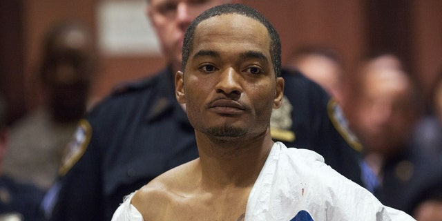 Suspect Demetrius Blackwell appears in court for his arraignment in Queens County Criminal Court in New York, May 3, 2015. Blackwell,wanted for illegal gun possession, was charged on Sunday with the attempted murder of a New York City plainclothes police officer who was shot in the head while pursuing the suspect in his unmarked car, authorities said.  REUTERS/Theodore Parisienne/Pool - TM3EB531AA101