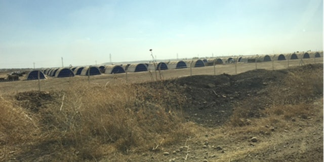 A camp of steel huts waits on the outskirts of Mosul, where a flood of refugees is expected to stream out of the city when the expected assault begins.