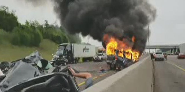 Flames erupt after a wrong way crash on Interstate 20 in Texas on Sunday.