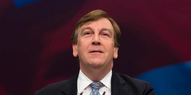 FILE - In this Monday Oct. 5, 2015 file photo, John Whittingdale, Secretary of State for Culture, Media and Sport speaks during the Conservative Party Conference, in Manchester, England. British opposition politicians are calling for government minister Whittingdale to give up authority over press regulation after he acknowledged that he had a relationship with a dominatrix - and that several newspapers knew about it but kept quiet. Culture Secretary John Whittingdale says he had a relationship in 2013-14 with a woman he later learned was a sex worker. No laws were broken, and Whittingdale said Wednesday, April 13, 2016 that the episode had no influence on his ministerial decisions. (AP Photo/Jon Super, file)