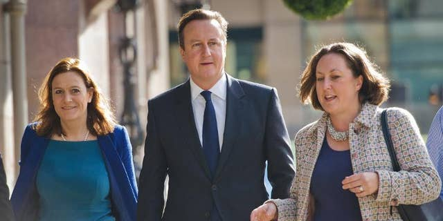 British Prime Minister David Cameron arrives at his hotel on the morning of the first day of the Conservative Party Conference in Manchester on September 29, 2013