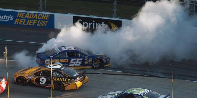 Sprint Cup Series driver Martin Truex Jr. (56) spins out as Marcos Ambrose (9) and Casey Mears (13) pass by during the NASCAR Sprint Cup  auto race at Martinsville Speedway in Martinsville, Va., Sunday, Oct. 27, 2013. (AP Photo/Steve Sheppard)