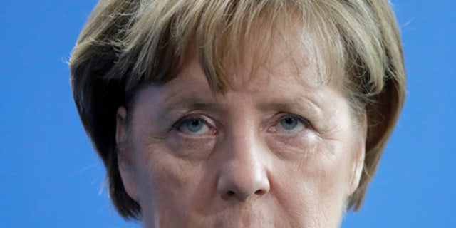 """German Chancellor Angela Merkel. Her administration has been called """"least cooperative"""" of the European powers participating in discussions about potential improvements to the Iran nuclear deal."""