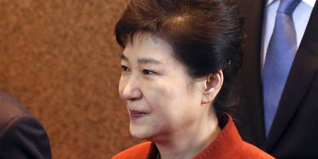South Korean President Park Geun-hye arrives to meets with National Assembly Speaker Chung Sye-kyun at the National Assembly in Seoul, South Korea, Tuesday, Nov. 8, 2016. South Korea's president said Tuesday she will allow parliament to choose her prime minister, a major political concession to growing anger as she scrambles to defuse an escalating influence-peddling scandal. (Bae Jae-man/Yonhap via AP)