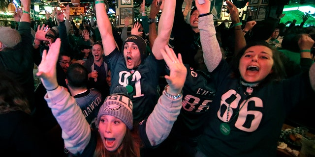 Fans react to an Eagles touchdown during Super Bowl 52 between the Philadelphia Eagles and the New England Patriots, Sunday, Feb. 4, 2018, in Philadelphia.