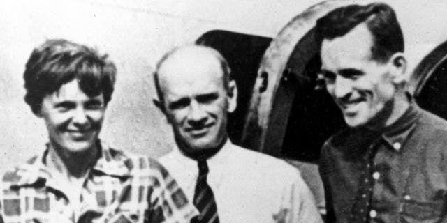 Earhart's navigator Fred Noonan is on the far right of this photo