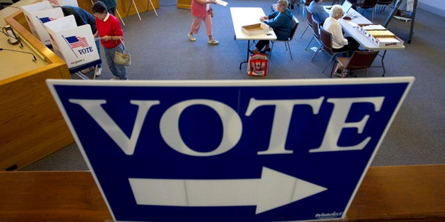 Oct. 25, 2012: Voters cast their votes through absentee ballots for the Nov. 6th election at the town hall in Cape Elizabeth, Maine.