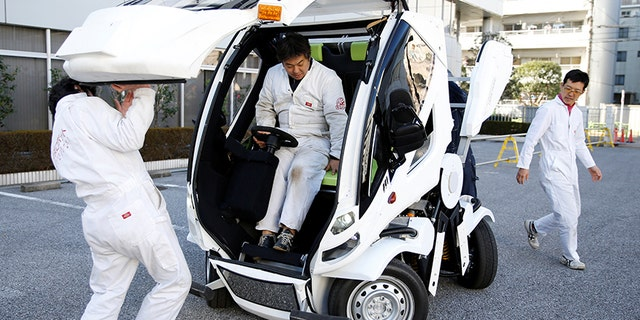 """Four Link Systems, Inc's fully electric foldable vehicle 'Earth-1' which was designed by Kunio Okawara, famous in Japan as the artist behind the long-running wildly popular robot anime """"Gundam"""", is seen in Tokyo, Japan December 27, 2017. Picture taken December 27, 2017. REUTERS/Toru Hanai - RC156C185F10"""