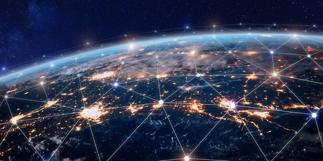 Global world telecommunication network with nodes connected around earth. Earth image from NASA (Credit: NASA)