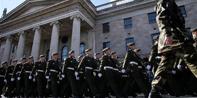 Thousands of soldiers march through the streets of Dublin, Ireland, Sunday, March 27, 2016. (AP Photo/Peter Morrison)