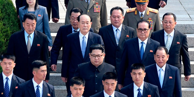 North Korean leader Kim Jong Un, center, is surrounded by his security guards upon his arrival for a meeting with South Korean President Moon Jae-in at the North Korean side of Panmunjom in the Demilitarized Zone., April 27, 2018.