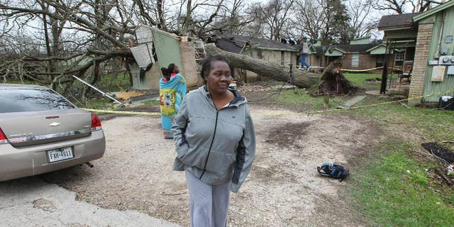 Faye Green was rescued through a bedroom window by her daughter after a large pecan tree fell on her home Tuesday in Wharton.