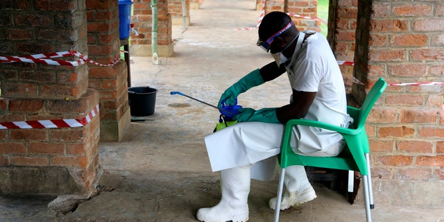 In this photo taken on Sunday, May 13, 2018, a health care worker wears virus protective gear at a treatment center in Bikoro Democratic Republic of Congo.