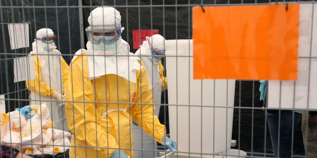 A volunteer for Medecins Sans Frontieres (MSF), or Doctors Without Borders, receives training on how to handle personal protective equipment during courses in Brussels October 15, 2014, which is aimed to help deal with the Ebola disease in West Africa. REUTERS/Francois Lenoir
