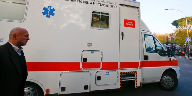 An ambulance carrying an Italian doctor, who contracted Ebola while working in Sierra Leone, arrives at the Lazzaro Spallanzani infectious diseases institute in Rome November 25, 2014. REUTERS/Tony Gentile