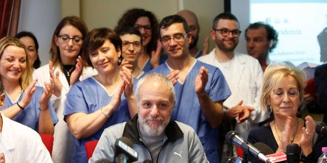 Italian Doctor Fabrizio Pulvirenti (C) attends a news conference at the Spallanzani hospital in Rome January 2, 2015.  REUTERS/Remo Casilli
