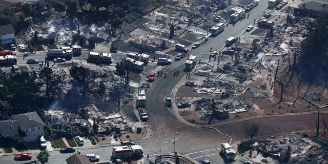 File-In this Sept.10, 2010 file photo firefighters and rescue crews work amongst damage caused by a pipeline explosion and an ensuing massive fire in a residential neighborhood in San Bruno, Calif. (AP Photo/Jeff Chiu,File)