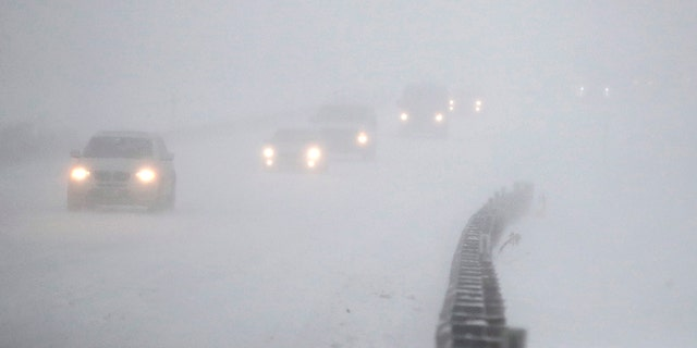 Vehicles commute southbound on the Garden State Parkway in whiteout conditions during the snowstorm on Thursday.