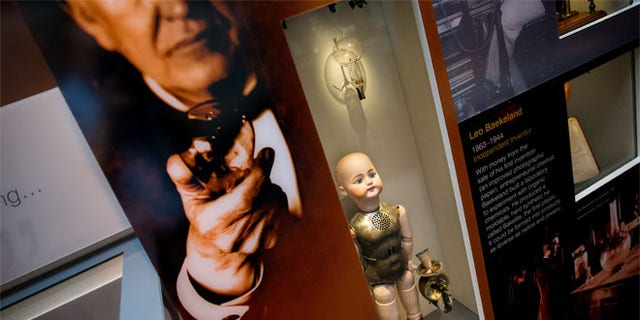 Thomas Edison's light bulb, top, and a talking dolls that was a flop are displayed at the American Enterprise exhibit at the National Museum of American History.