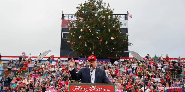 "FILE - In this Saturday, Dec. 17, 2016, file photo, President-elect Donald Trump speaks during a rally at Ladd-Peebles Stadium in Mobile, Ala. Authorities in Mobile said the tree cut down in a city park and used as a prop at Trump's recent rally will be used to build cat scratching posts and bird houses. The mayor's chief of staff apologized for his role in having the large cedar tree cut down, saying he was ""overzealous"" in trying to meet expectations of Trump's team. (AP Photo/Evan Vucci, File)"