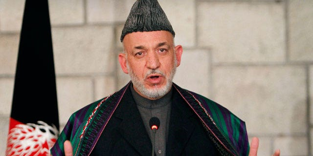 Dec. 14, 2011: Afghan President Hamid Karzai speaks during a joint news conference with U.S. Defense Secretary Leon Panetta, unseen, at the presidential palace in Kabul, Afghanistan.