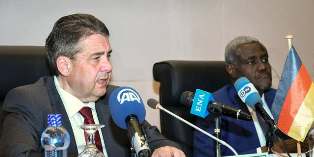 Germany's Foreign Minister Sigmar Gabriel, left, speaks to media accompanied by African Union (AU) chairman Moussa Faki Mahamat, at the AU headquarters in Addis Ababa, Ethiopia Tuesday, May 2, 2017. Germany's foreign minister and the African Union chief say setting up camps in North Africa will not solve Europe's migrant crisis and that stabilizing African countries is a better strategy. (AP Photo/Daniel Getachew)
