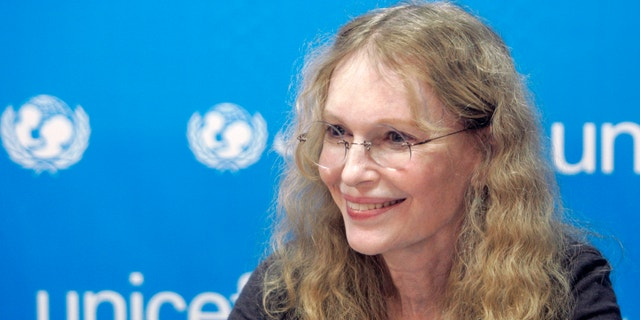 U.S. actress Mia Farrow, a UNICEF goodwill ambassador, holds a news conference in Gaza city October 15, 2009.