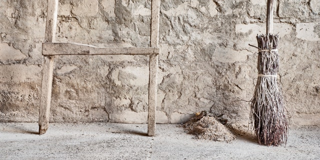 grunge wall, ladder and wooden broom background