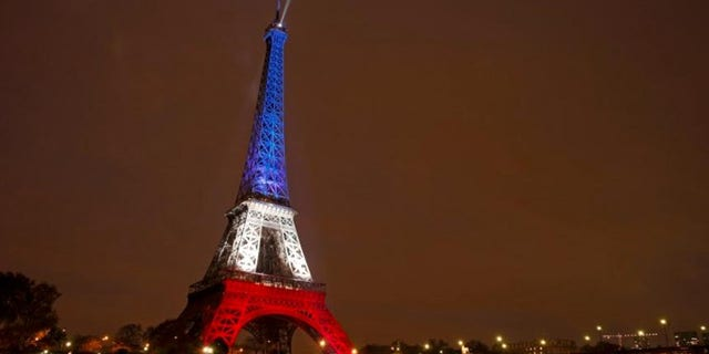 Nov. 16, 2015: The Eiffel Tower is lit with the blue, white and red colors of the French flag in Paris to pay tribute to the victims of a series of deadly attacks on Friday in the French capital.