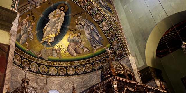 A view of the mosaic of transfiguration which covers the surface of 46 meters square inside the basilica of the monastery of Saint Catherine is shown on Saturday, Dec 16, 2017 in South Sinai, Egypt.